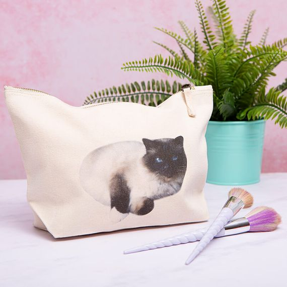 Make-up bag that has been personalised with a picture of a cat.